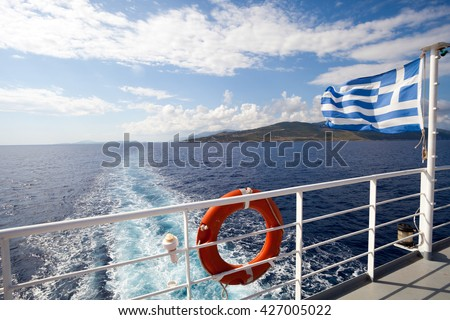 Ferry boat in Greece view on sea and islands with cruise ship trail - stock photo