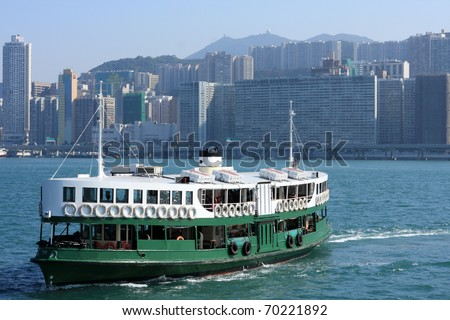 Ferry boat in Victoria Harbor, Hong Kong - stock photo