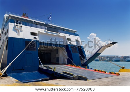 Ferry boat prepares to leave the port of Piraeus - stock photo