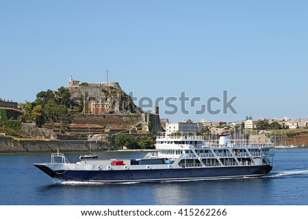 ferry boat sails close to old fortress  Corfu town - stock photo