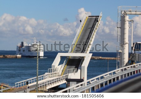 ferry comes in at ferry terminal - stock photo