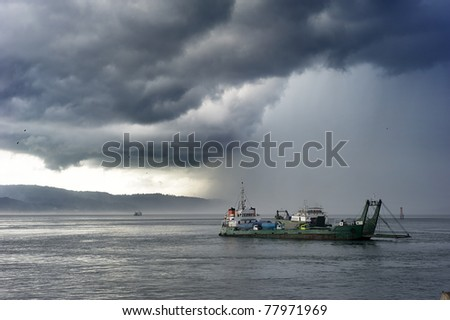Ferry from Java to Bali under the storm. Indonesia