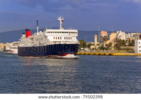 Ferry leaves the port of Piraeus - stock photo