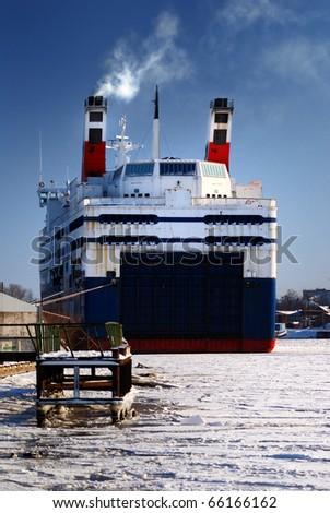 ferry near port in winter - stock photo