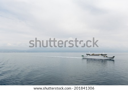 Ferry on a calm sea - stock photo
