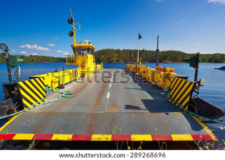 Ferry over lake in Finland standing at shore. - stock photo