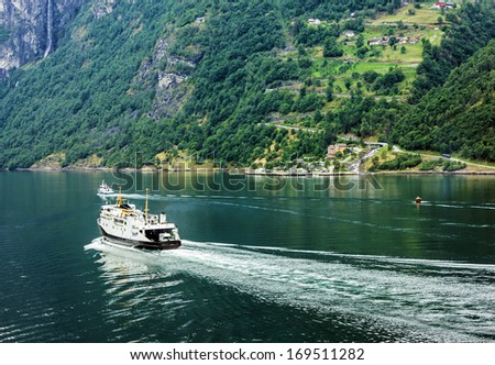 Ferry ship in Geiranger fjord, Norway.