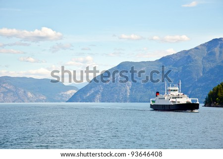 Ferryboat cruising on Norwegian fjord - stock photo