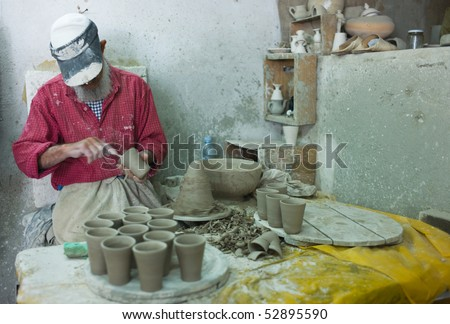 FES - APRIL 17: Morrocan man shapes pottery  April 17, 2010 in Fes, Morocco. - stock photo