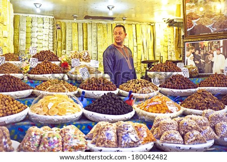 FES, MAROCCO - October 17 2013 : Merchant is selling dried fruits and nuts in the medina from Fes on October 17, 2013 - stock photo