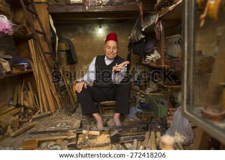 FES, MOROCCO, April 19: Unkown man selling wood materials in traditional store in Fes, Morocco on 19 April 2015. FEZ is the Unesco World Heritage Site - stock photo