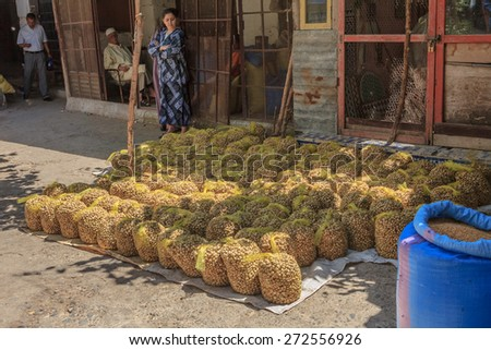 Fes, Morocco - May 11, 2013: Snails in bags for sale at the Moroccan souk, Moroccan market in the medina - stock photo