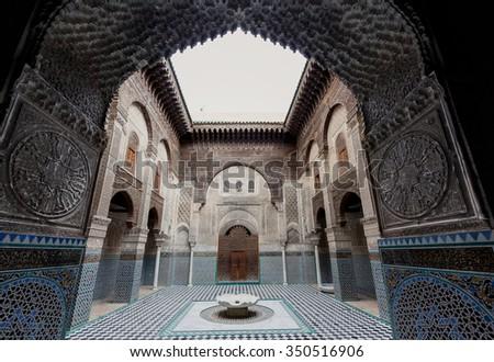 FES, MOROCCO - NOVEMBER 1, 2015: Al-Attarine Madrasa, Fes medina, Morocco. It was built by the Marinid sultan Uthman II Abu Said in 1323-5. - stock photo