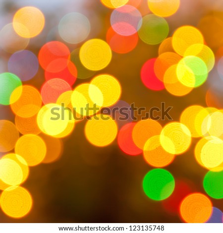 Festive abstruct art. Christmas Tree lights and decoration bokeh blurred out of focus background.