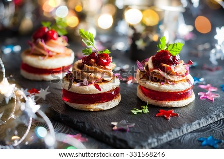 Festive appetizer with foie gras, cranberry chutney and jelly - stock photo