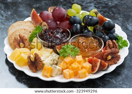 festive appetizers - cheeses, fruits and jams, horizontal