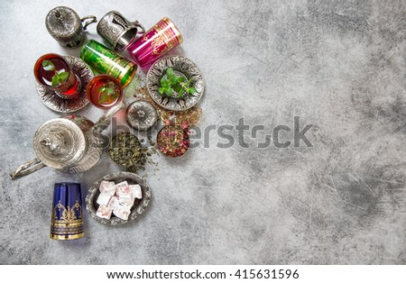 Festive arabic tea table setting. Oriental hospitality. Ramadan kareem. Muslim holidays. Islamic holidays. Tea drink. Herbal tea. Tea glasses. Tea pot. Tea cups - stock photo