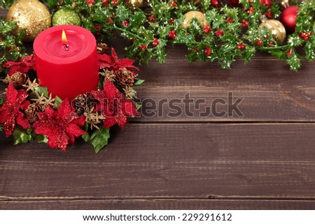 Festive background scene of candle with decoration of Christmas ornament on wooden table with copy space