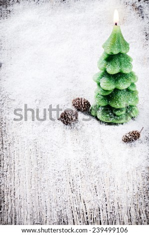 Festive background with Christmas tree candle and pine cones  - stock photo
