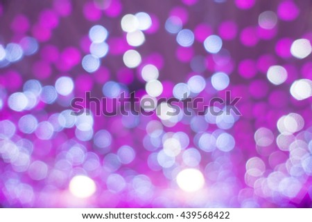 Festive background with defocused lights - stock photo
