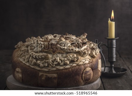 Festive baked bread on wooden background. Traditional food