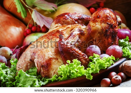 Festive baked chicken with autumn berries, fruits, nuts and vegetables ...