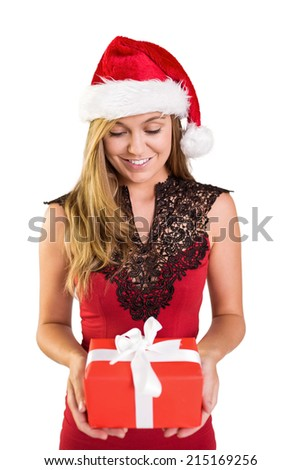 Festive blonde holding a gift on white background