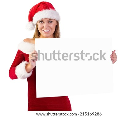 Festive blonde smiling at camera holding poster on white background