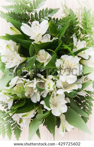 Festive bouquet of beautiful white hibiscus flowers. Big petals and pistil. Beauty in nature. Wedding bouquet. Natural decoration. - stock photo