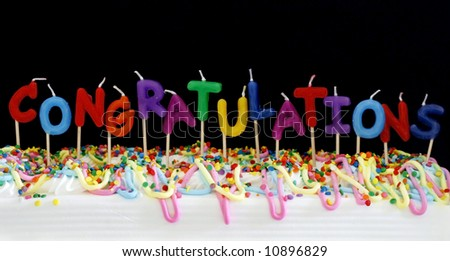 """festive cake with candles spelling """"congratulations"""" - stock photo"""