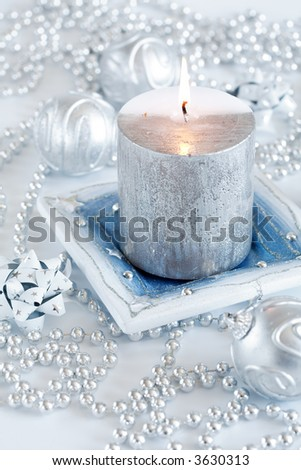 Festive candle as Christmas motive in silver and white tones - stock photo