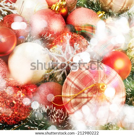 Festive Christmas background of xmas balls and decorations under defocused bokeh effect on the foreground - stock photo