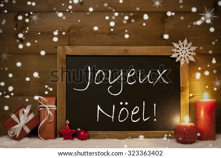 Festive Christmas Card With Chalkboard, Red Gifts, Christmas Balls, Snowflakes And Candles. Christmas Decoration With Vintage Wooden Background. FrenchText Joyeux Noel Mean Merry Christmas - stock photo