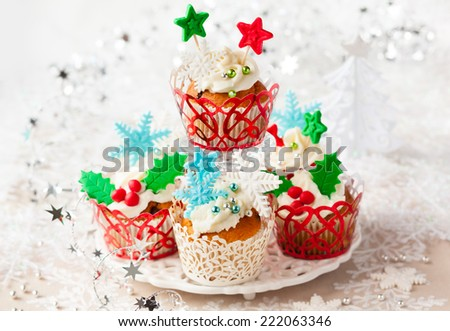 Festive Christmas cupcakes with vanilla frosting and sugar decoration - stock photo