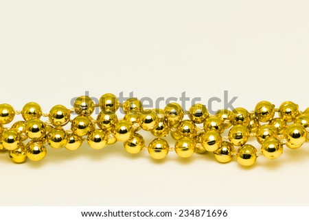 Festive Christmas gold jewelry for the Christmas tree - stock photo