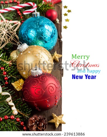 Festive decorations with baubles on wood border - stock photo