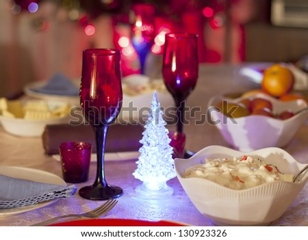Festive dinner with wine glasses, dishes and illumination