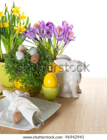 festive easter table setting with bunny and eggs decoration on white background - stock photo