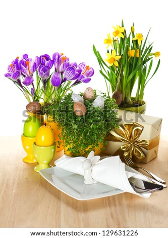 festive easter table setting with spring flowers and eggs decoration on white background - stock photo