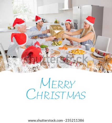 Festive family exchanging gifts against merry christmas - stock photo