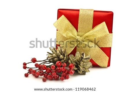 Festive gift box with bow  and christmas decoration isolated on white background - stock photo
