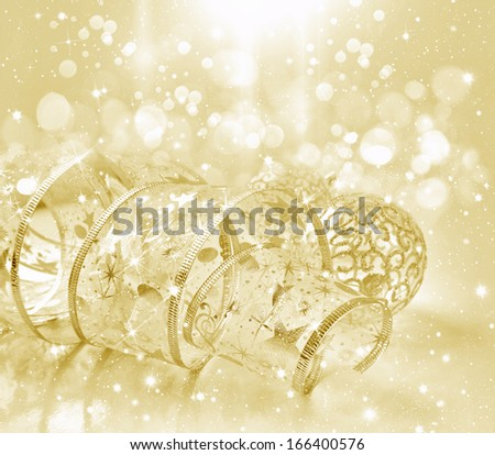 Festive gold background with christmas ribbon - stock photo
