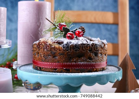 Festive holiday table with English style Christmas fruit cake with glamorous table setting with pink candles & Festive Holiday Table English Style Christmas Stock Photo 749088442 ...