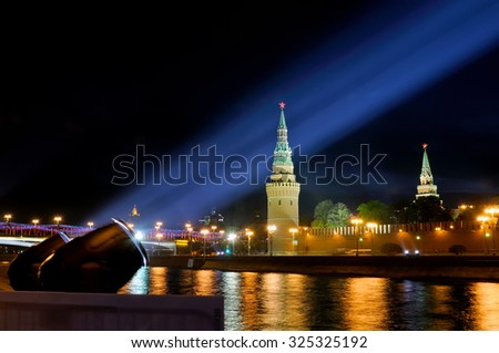 Festive illumination of the Moscow Kremlin at night. Beams of searchlights shine on towers and walls of the Kremlin. - stock photo
