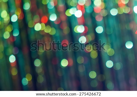 Festive Lights Bokeh. Abstract background spherical bokeh of colorful festive lights in shades of red and green.