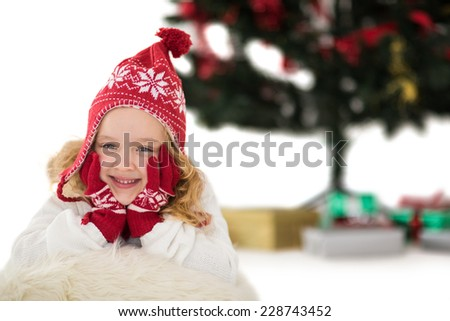 Festive little girl in hat and scarf on white background