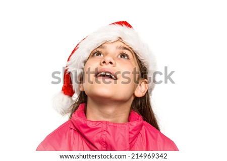 Festive little girl looking surprised on white background