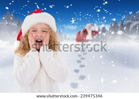 Festive little girl with hands on face against bright blue sky over clouds - stock photo