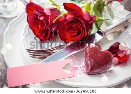 Festive place setting for Valentines day - stock photo