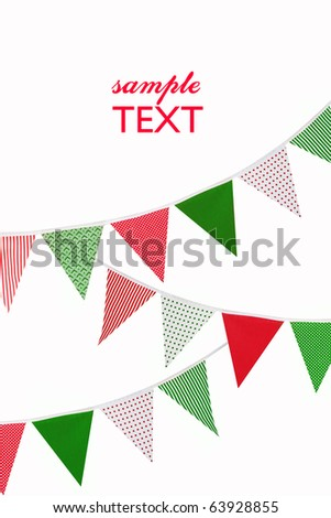festive red, green and white bunting flags on white background with space for text - stock photo
